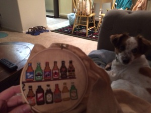 Everything in this photo.  Cross stitching, cute dog perking up, cuddles... love it.  #dayseven #100happydays